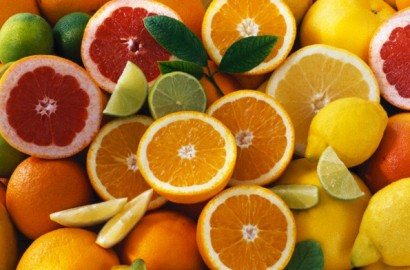 Citrus fruits, whole and halved --- Image by © Maximilian Stock/the food passionates/Corbis